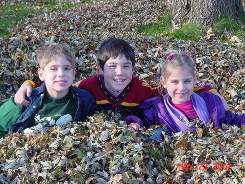 Kids in leaves 112302